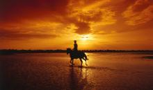 Reiten bei Sonnenuntergang