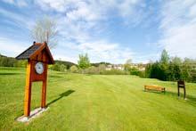 Uhr auf dem Golfplatz